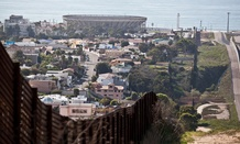 The current border fence is shown in 2012 with Tijuana on the left and California on the right.