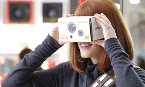 A customer tries out one of Star Wars Google Cardboard Virtual Reality viewers