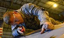 Airman 1st Class Jesse Gordon, a 436th Maintenance Squadron crew chief, works on an aircraft.