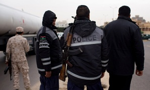 Libyan policemen stand guard at a checkpoint in Sabratha, Libya, in February 2015. U.S. airstrikes on Friday targeted an ISIS facility in the town.