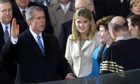 "George W. Bush takes the oath of office in January 2001. Clinton staffers reportedly removed the ""W"" keys from White House keyboards before leaving."