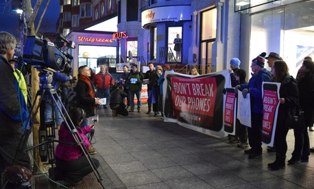 Protestors rallied outside of a Boston Apple Store Tuesday night.