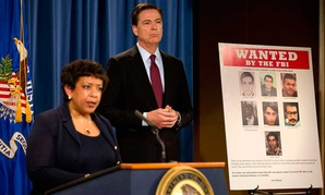 U.S. Attorney General Loretta Lynch, left, and FBI Director James Comey announce the indictments of seven Iranian hackers.