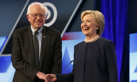 Democratic presidential candidates Hillary Clinton and Sen. Bernie Sanders shake hands before the start of a March 9 debate in Miami.