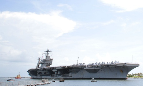 The USS Abraham Lincoln arrives for a scheduled port visit in Florida. Dusek was found to have steered the aircraft carrier to Port Klang, Malaysia – a port terminal owned by Francis.