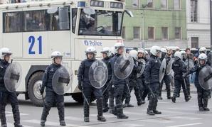 Riot police secure a zone in the Molenbeek neighborhood in Brussels, Belgium.