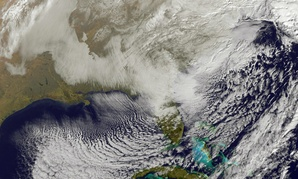 This image taken by NOAA's GOES-East satellite on Saturday, Jan. 23, 2016, shows a large winter snowstorm over the East Coast of the United States.