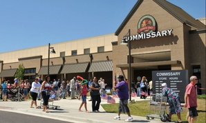 Customers walk by the commissary at Fort Campbell, Ky. on June 13, 2012.