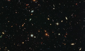 This image by the Hubble Space Telescope reveals thousands of colorful galaxies swimming in the inky blackness of space.