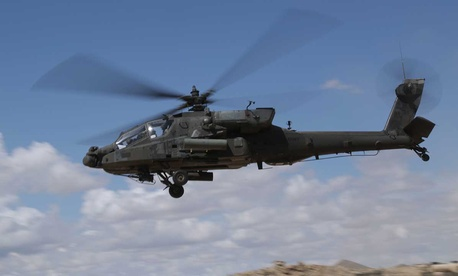 Soldiers pilot an AH-64D Apache Longbow during a training exercise last week.