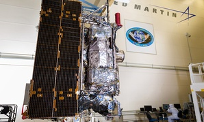 The fully assembled GOES-R satellite with its solar array stowed, in a clean room at Lockheed Martin.