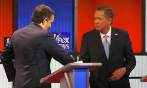 Republican presidential candidates Ted Cruz (left) and John Kasich shake hands after a debate March 3.
