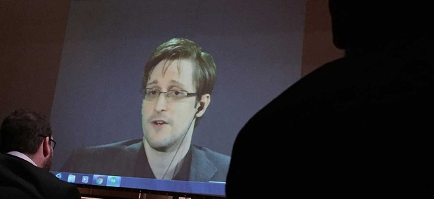 Edward Snowden speaks via video conference to people in the Johns Hopkins University auditorium in February.