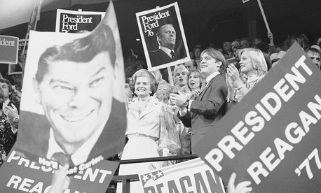First Lady Betty Ford, left, stands surrounded by signs supporting Pres. Gerald Ford and Ronald Regan at the nominating session of the 1976 GOP convention.