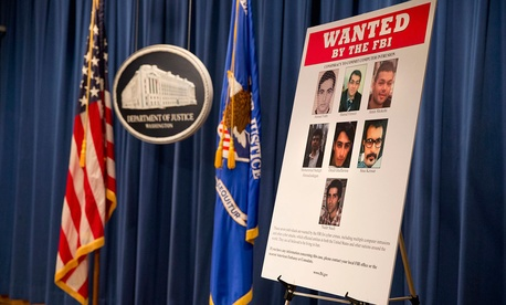 A poster lists Iranians who are wanted by the FBI for computer hacking.