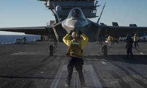 An F-35C Lightning II carrier variant is prepared for launch aboard the aircraft carrier USS Nimitz (CVN 68).