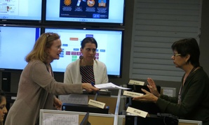 Workers from the Puerto Rico Health Department and CDC review Zika-related data.