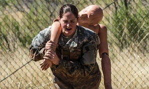Sgt. 1st Class Kristina Martinelli evacuates a casualty at the obstacle course in 2015.