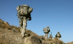 U.S. Army soldiers patrol in the mountains near Sar Howza, Paktika province, Afghanistan.