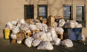 Trash piles up outside a building in New York City.