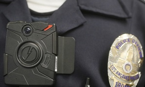 A Los Angeles Police officer wears an on-body camera during a demonstration.