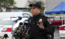 Montgomery County, Md. Police Capt. Paul Starks speaks to the media in the parking lot outside the Westfield Montgomery Mall in Bethesda, Md., Friday after a shooting.