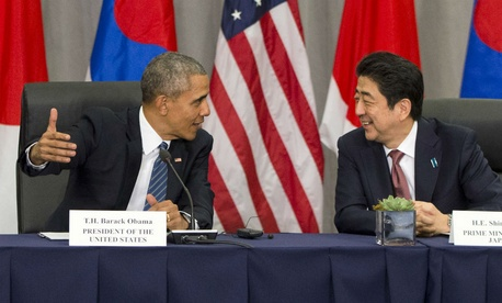 President Obama speaks with Japanese Prime Minister Shinzo Abe during their meeting at the Nuclear Security Summit in Washington in late March.