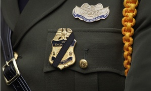 A U.S. Border Patrol Agent wears a black stripe over his badge during the 22nd Annual Blue Mass ceremony kicking off National Police Week at St. Patrick's Catholic Church in Washington, May 3.