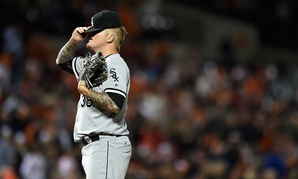 Chicago White Sox pitcher Mat Latos hides his face in his hat after giving up home runs in an April game.