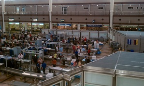 Passengers go through security at Denver International Airport in 2010.