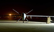 An MQ-9 Reaper sits on the flight line at Hurlburt Field, Fla., in 2014.