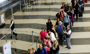 Passengers wait in a screening line at Chicago's O'Hare International Airport.
