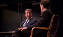 Carter participates in a moderated discussion with U.S. Naval War College Dean of Academics Phil Haun Wednesday.
