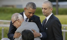 Obama hugs Shigeaki Mori, an atomic bomb survivor and a creator of the memorial for American WWII POWs killed in Hiroshima.