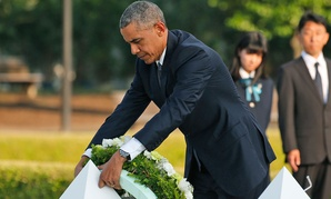 Obama lays wreaths at the cenotaph at Hiroshima Peace Memorial Park Friday.