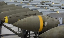 A dozen 2,000-pound joint direct attack munitions sit inside a warehouse at Al Udeid Air Base, Qatar, in December.