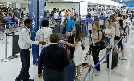 Travelers stand in line as they prepare to be screened at a Transportation Security Administration checkpoint at Fort Lauderdale-Hollywood International Airport, Friday, May 27, 2016, in Fort Lauderdale, Fla. Memorial Day week.