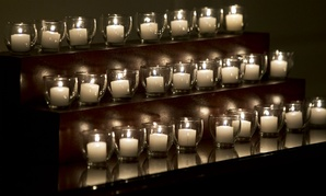 Candles in the White House honor the victims of the Newtown elementary school shooting in December 2012.