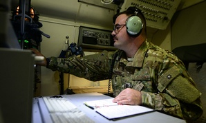 1st Lt. Cory Snyder, 7th Expeditionary Airborne Command and Control Squadron joint surveillance target attack radar systems navigator sets up computer systems.