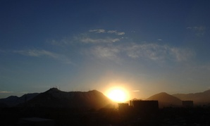 The sun sets near Kabul in 2011.