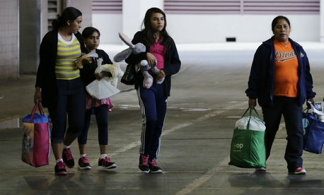Immigrants from El Salvador and Guatemala head to a bus after being released from a family detention center in San Antonio, Texas.