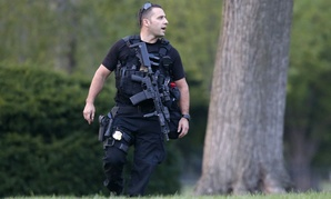 A member of the U.S. Secret Service Emergency Response Team stands watch on the North Lawn at the White House.