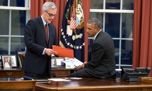 Barack Obama confers with Chief of Staff Denis McDonough in the Oval Office  in 2015.