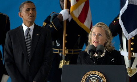 Clinton and Obama appear together at Andrews Air Force Base in 2012.