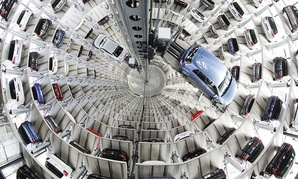Volkswagen cars are presented to media inside a delivery tower prior to the company's annual press conference in Wolfsburg, Germany, Thursday, April 28, 2016.