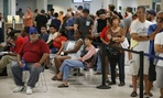 People wait in line at a Nevada Department of Motor Vehicles office in Las Vegas last summer.