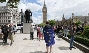 A demonstrator wrapped in the EU flag takes part in a protest opposing Britain's exit from the European Union in Parliament Square last week.