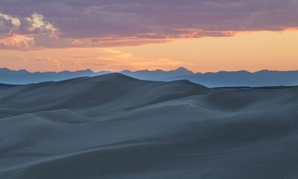 The St. Anthony Sand Dunes appears as a rolling sea of sand on the eastern edge of Idaho's volcanic Snake River Plain.