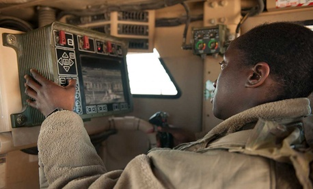 Senior Airman Amanda Nolan, 451st Expeditionary Support Squadron Security Forces Flight, scans a sector on a common remote operating weapons station from vehicle at Delta-1 Post on Kandahar Airfield.