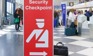 A sign directs travelers toward security checkpoints at O'Hare International Airport in Chicago in April.